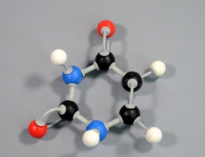 Molecule model of the DNA element Uracil. Black is Carbon, Red is Oxygen, White is Hydrogen, Blue is Nitrogen stock photo