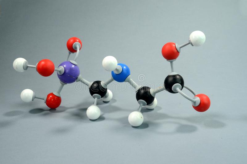 Molecule Model of Glyphosphate, a common pesticid. Black is Carbon, Red is Oxygen, white is Hydrogen, Blue is Nirogen, and violet is Phosphorous stock photos