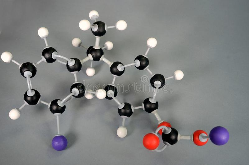 Molecule model of polycarbonate. As used in protection glass. White is Hydrogen, black is Carbon, red is  Oxygen. Lilac marks the beginning and end where a new stock images