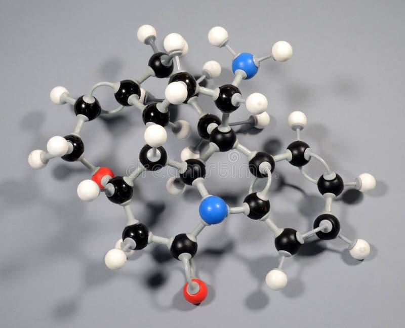 Molecule model of Strychnine. Black is Carbon, Red is Oxygen, White is Hydrogen, Blue is Nitrogen royalty free stock image