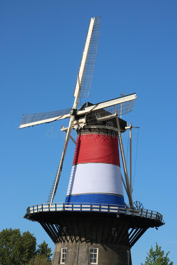 Molen De Valk windmill in Leiden, Netherlands. View of the upper part of Molen De Valk, a historic windmill now a museum in Leiden, Netherlands that is decorated stock image
