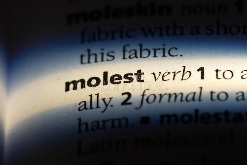 Molest. Word in a dictionary.  concept stock image