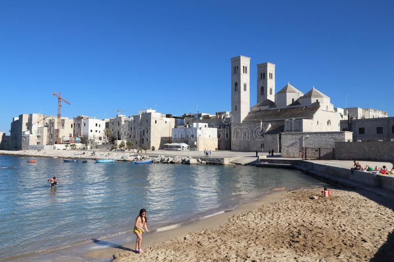 Molfetta, Italy. MAY 28, 2017: People visit Molfetta beach in Apulia region, Italy. With 50.7 million annual visitors Italy is one of the most visited stock photos