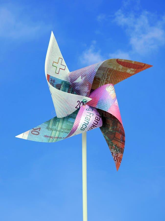 Molino de viento del juguete del dinero de Frank del suizo fotos de archivo