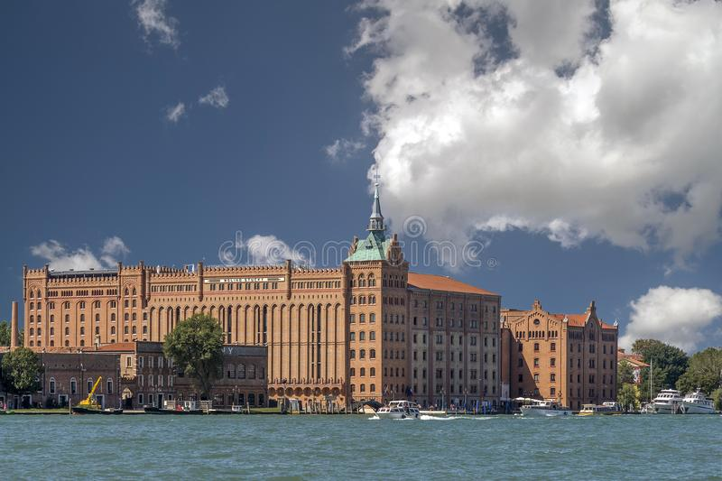 Molino Stucky, Venice, Italy. Europe against beautiful sky and clouds royalty free stock image