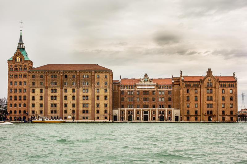 Molino Stucky. VENICE- MARCH 14:At the west corner of the Giudecca, Molino Stucky is an anomaly on the Venice panorama, a new gothic industrial building stock image