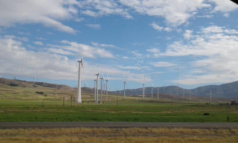 Molinoes de viento en el trabajo fotografía de archivo