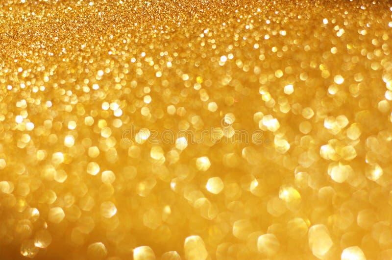 Molla dell'oro o fondo di estate. Fondo astratto elegante con le luci defocused del bokeh fotografie stock