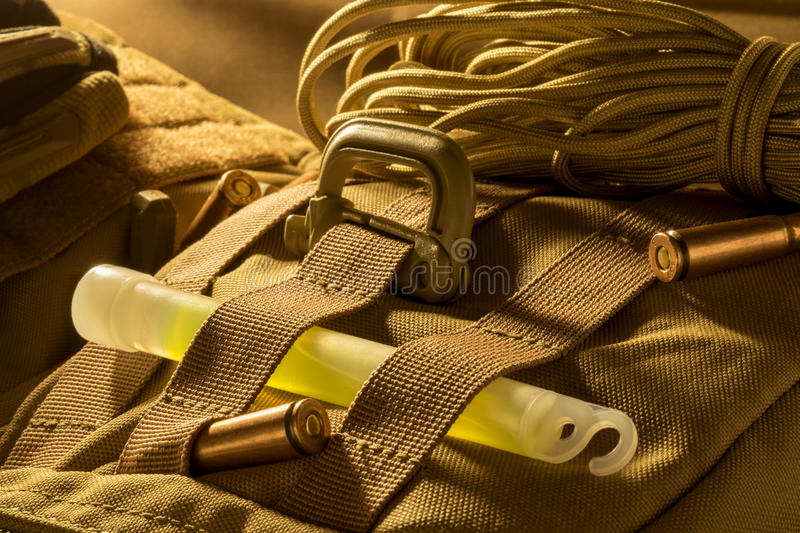 Molle plate with carabineer and glow stick stock photos