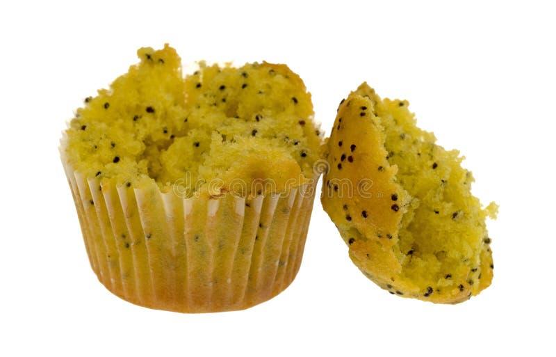 Mollete de la semilla de amapola del limón del tamaño de la mordedura roto imagen de archivo libre de regalías