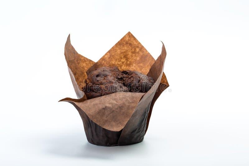 Mollete del chocolate en el fondo blanco Postre de la hornada del chocolate fotografía de archivo libre de regalías