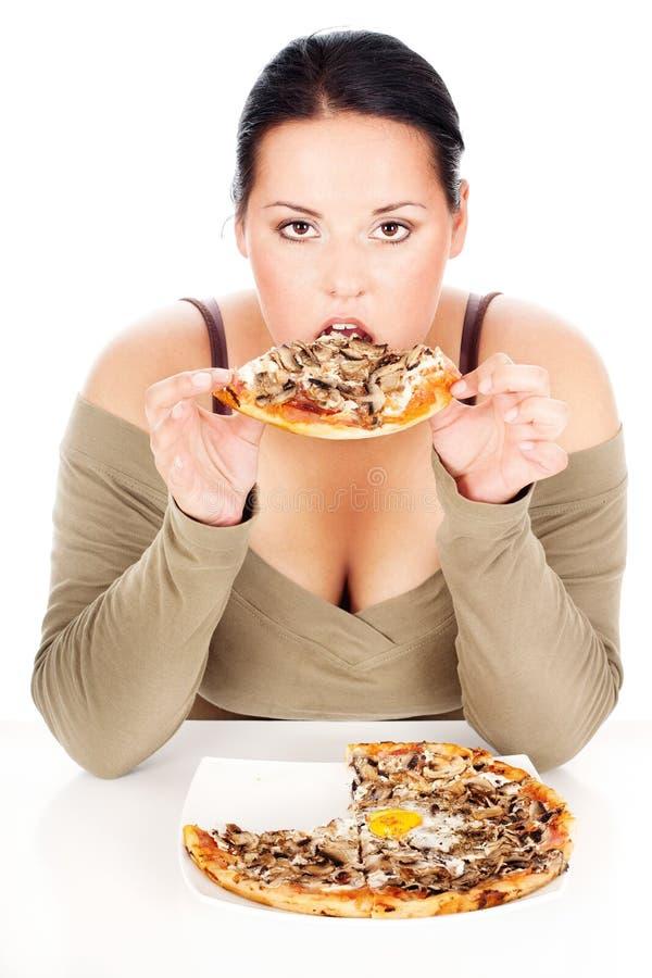 Mollige vrouw en tastefully pizza stock foto's