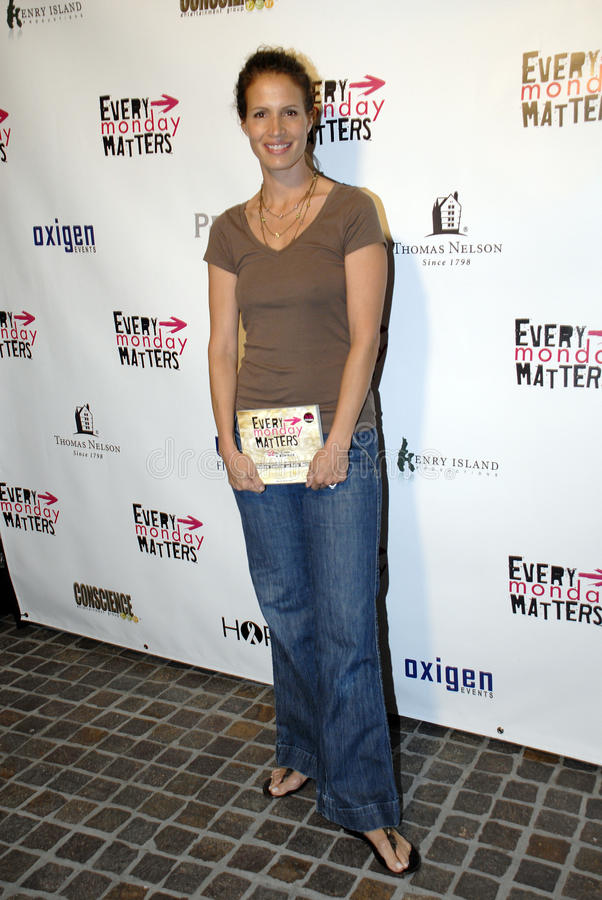 Molly Culver on the red carpet. Molly Culver holding the book Every Monday Matters benefiting two families with children afflicted with leukemia in March 2008 stock image