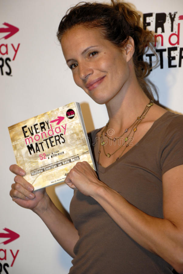 Molly Culver on the red carpet. Molly Culver holding the book Every Monday Matters benefiting two families with children afflicted with leukemia in March 2008 royalty free stock photography