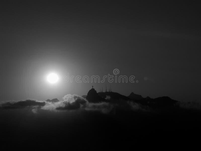Moln, solnedgång och Jesus arkivfoto
