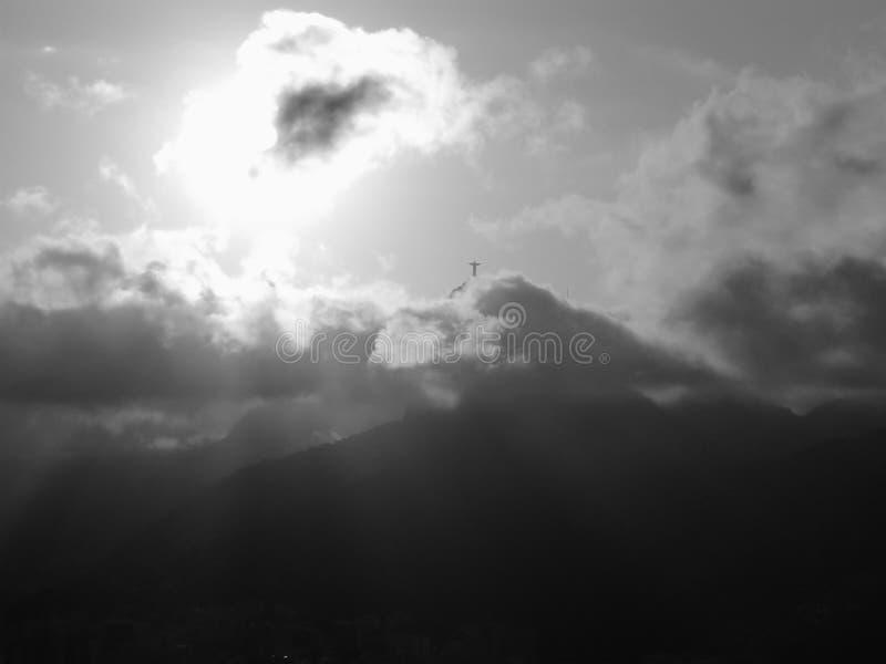 Moln, solnedgång och Jesus royaltyfri bild