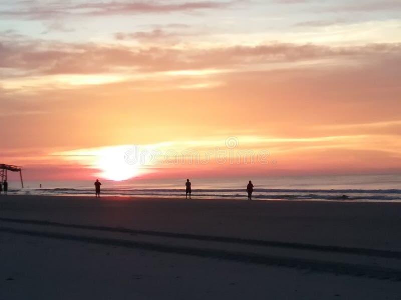 Molo, tłum, wschód słońca fotografia royalty free