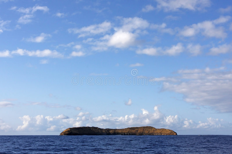 Molokini Crater Maui. A favorite tourist spot for snorkeling and diving off the coast of Maui royalty free stock photography