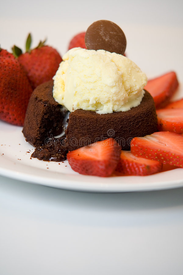 Molten Chocolate Cake. With Ice Cream and Strawberries stock photo