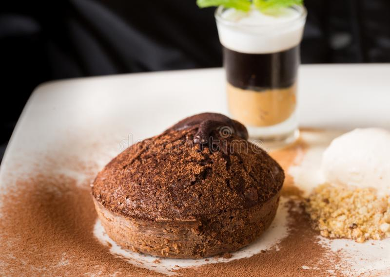 Molten chocolate cake with peanut butter shooter. Molten chocolate cake with peanut butter shooter stock images