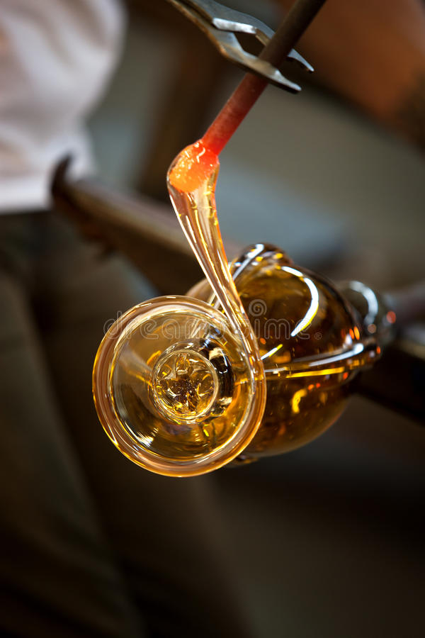 Molten Glass Close Up. Close up of red hot molten glass with pliers royalty free stock image