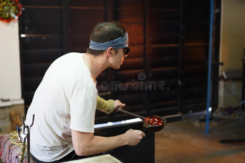 Molten glass cools when worked royalty free stock photo