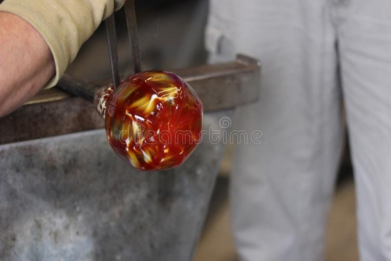 Molten glass on a metal rod for glass blowing macro royalty free stock photos