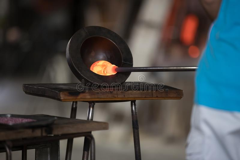 Molten glass on a metal rod. For glass blowing royalty free stock photos