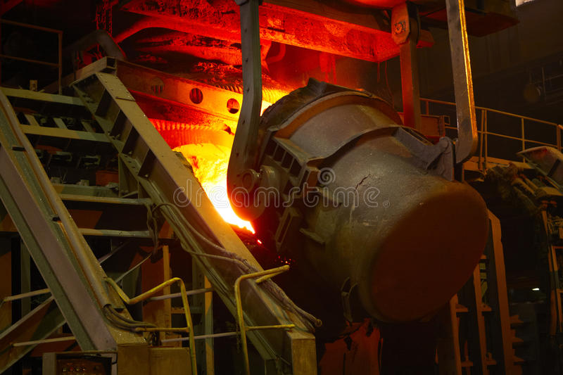 Molten hot steel. Is pouring - Industrial metallurgy stock photo