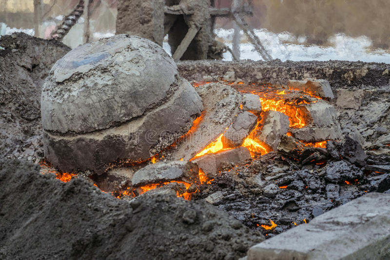 Molten incandescent in dump. Wastes from the metallurgical industry stock photography