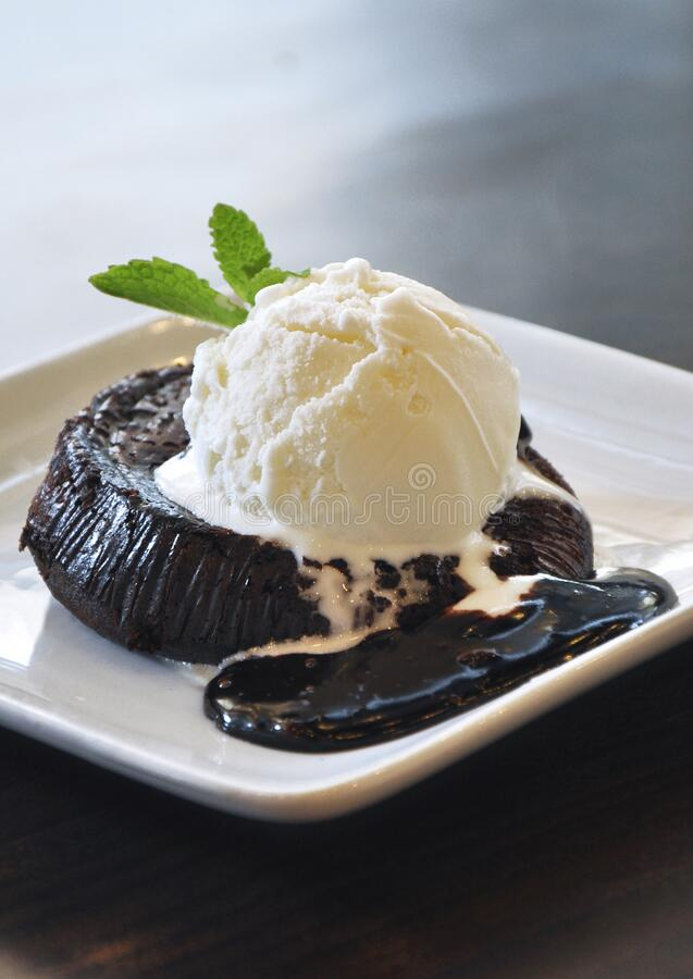 Molten lava cake with delicious chocolate sauce stock photography