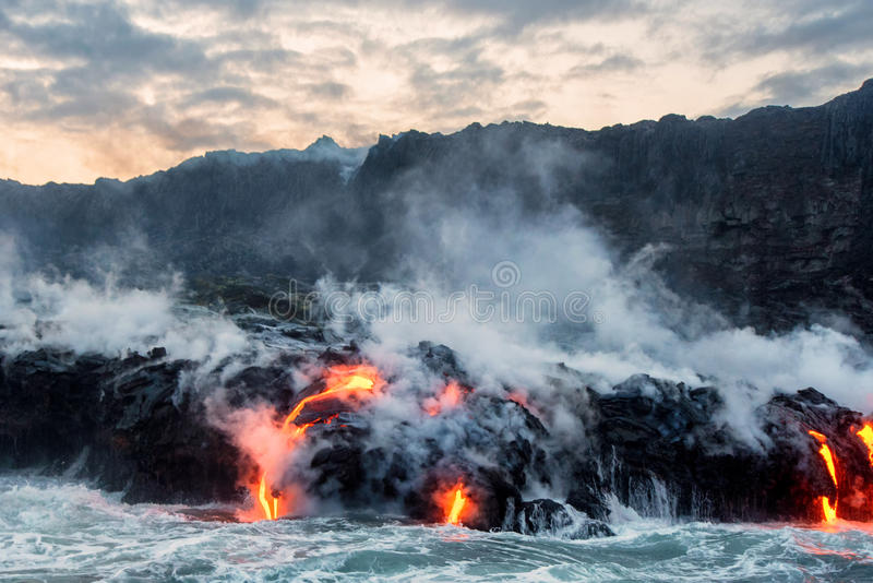 Molten lava flowing into the Pacific Ocean. On Big Island of Hawaii, creating new earth royalty free stock photos