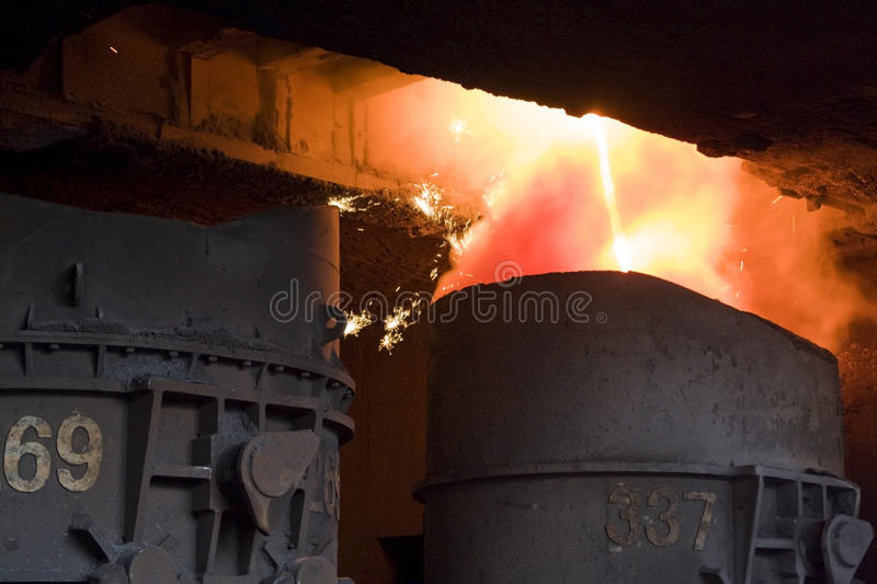 Molten steel. Red-hot molten steel in a iron and steel enterprise production scene stock photography
