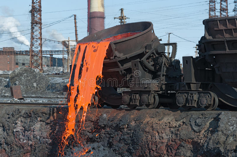The molten steel is poured into the dump. stock photos