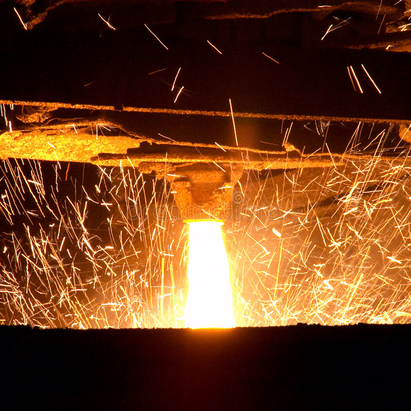 Molten steel pouring. And sparkes stock photo