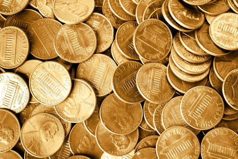 Molto U.S.A. brillante le monete da un centesimo come fondo fotografie stock libere da diritti