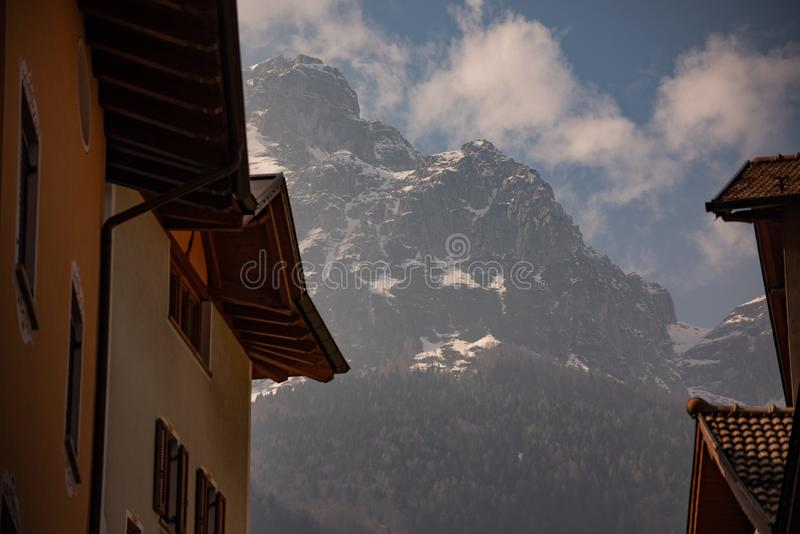 Houses with mountain views,. Molveno, Trentino, Italy. Alpine landscape with clouds and snow stock photos