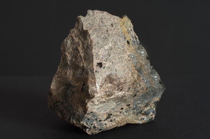 Molybdenite mineral on black background royalty free stock photography