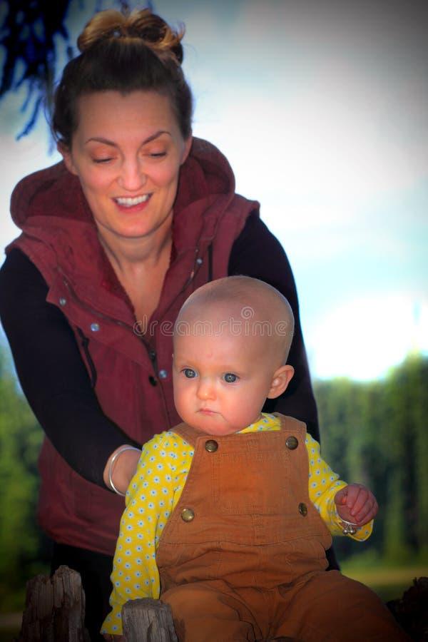 Mom Backing Baby stock photos
