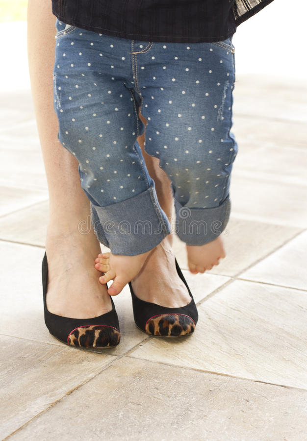 Mom and child feet royalty free stock photos