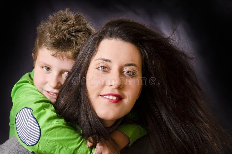 Mom and child hug. stock photography