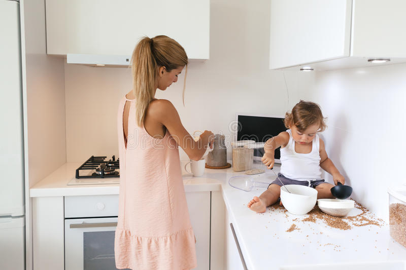 Mom with child in the kitchen royalty free stock image