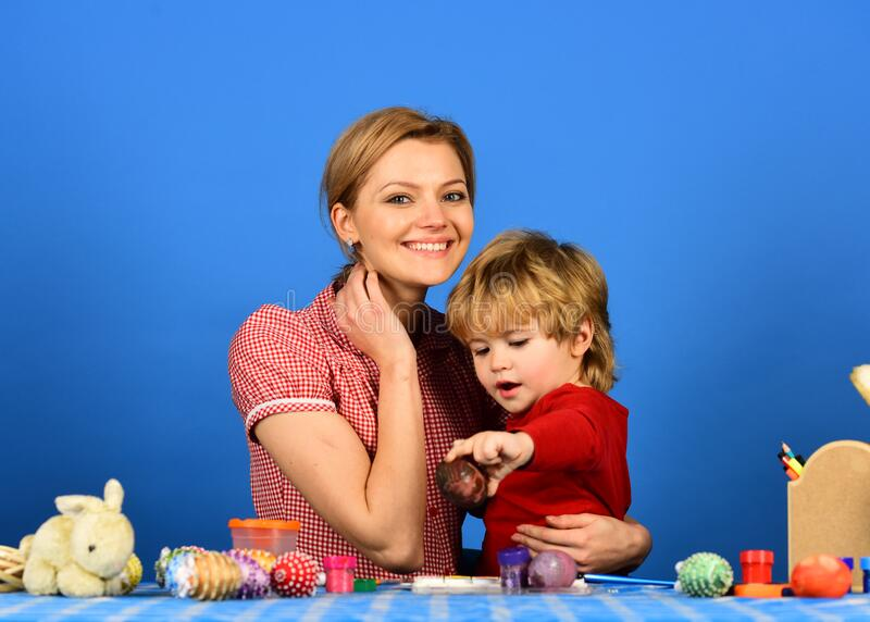 Mom and child spend time together. Woman and little boy stock image