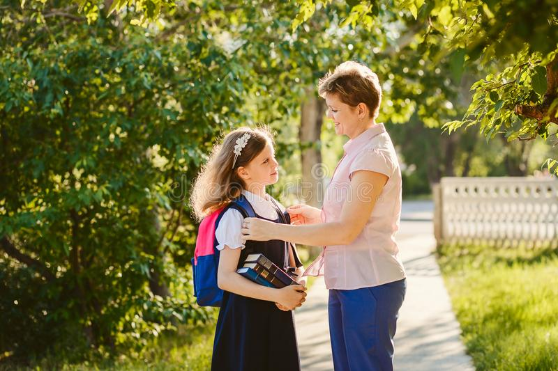 Mom collects her daughter to school royalty free stock image