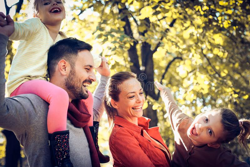 Mom and Dad have play with daughters. royalty free stock photos