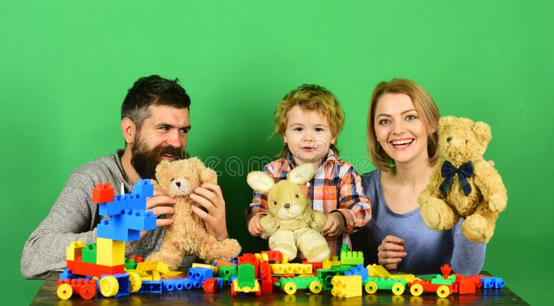 Mom, dad and kid in playroom. Man, woman and boy royalty free stock images