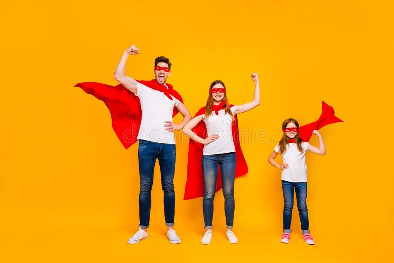 Mom dad and little foxy lady playing cartoon characters wear superhero capes isolated yellow background. Mom dad and little foxy, lady playing cartoon characters stock photos