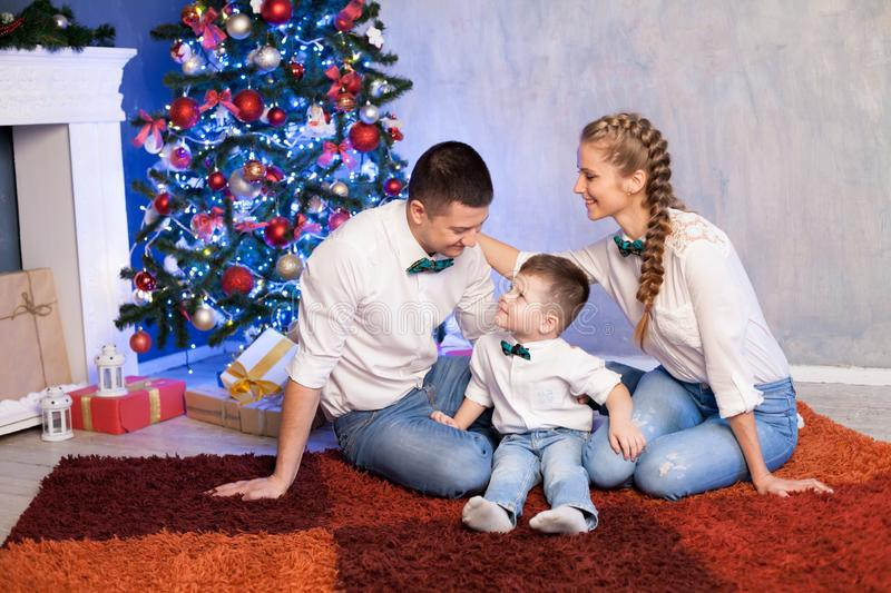 Mom dad and young son at Christmas New Year holiday gifts stock photography