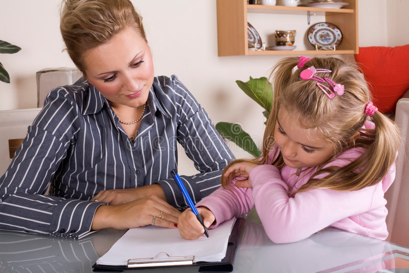 Mom and daughter. Mom is helping her daughter with homework royalty free stock photos