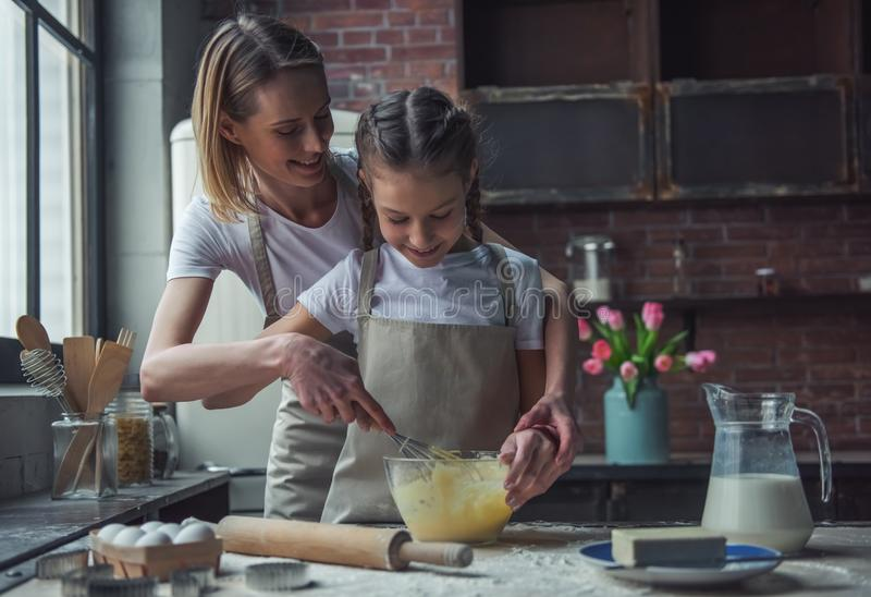 Mom and daughter baking stock photography